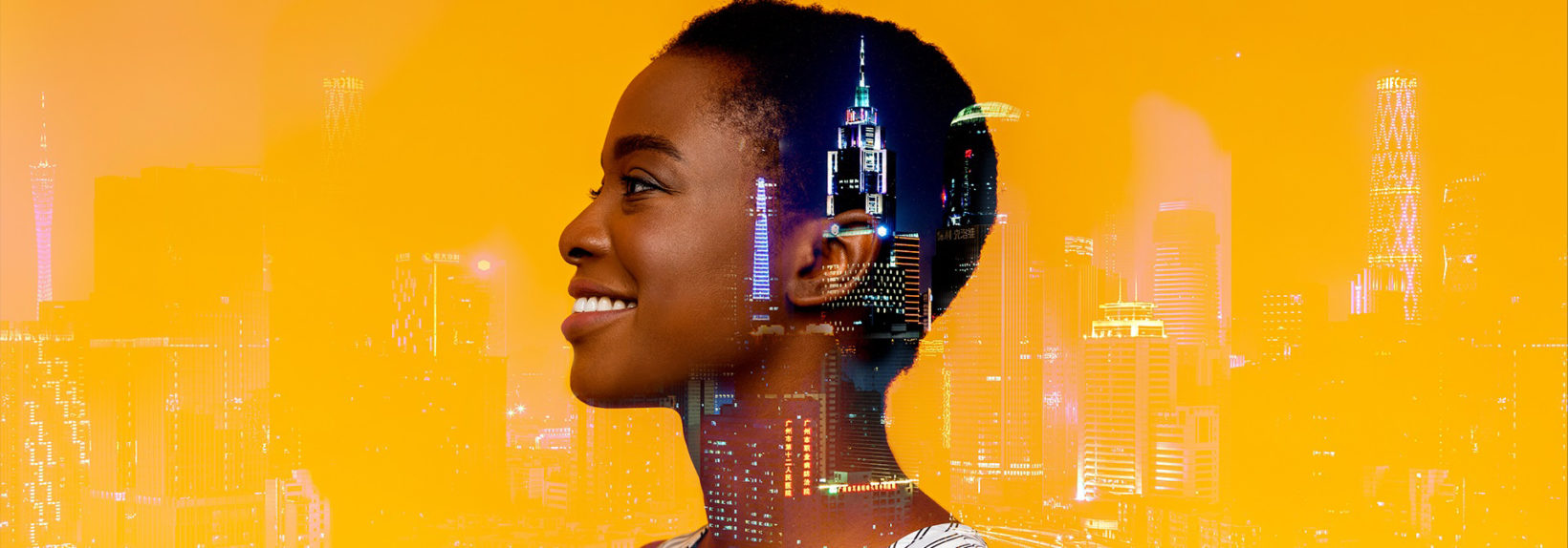 Profile of smiling woman, cityscape superimposed on face